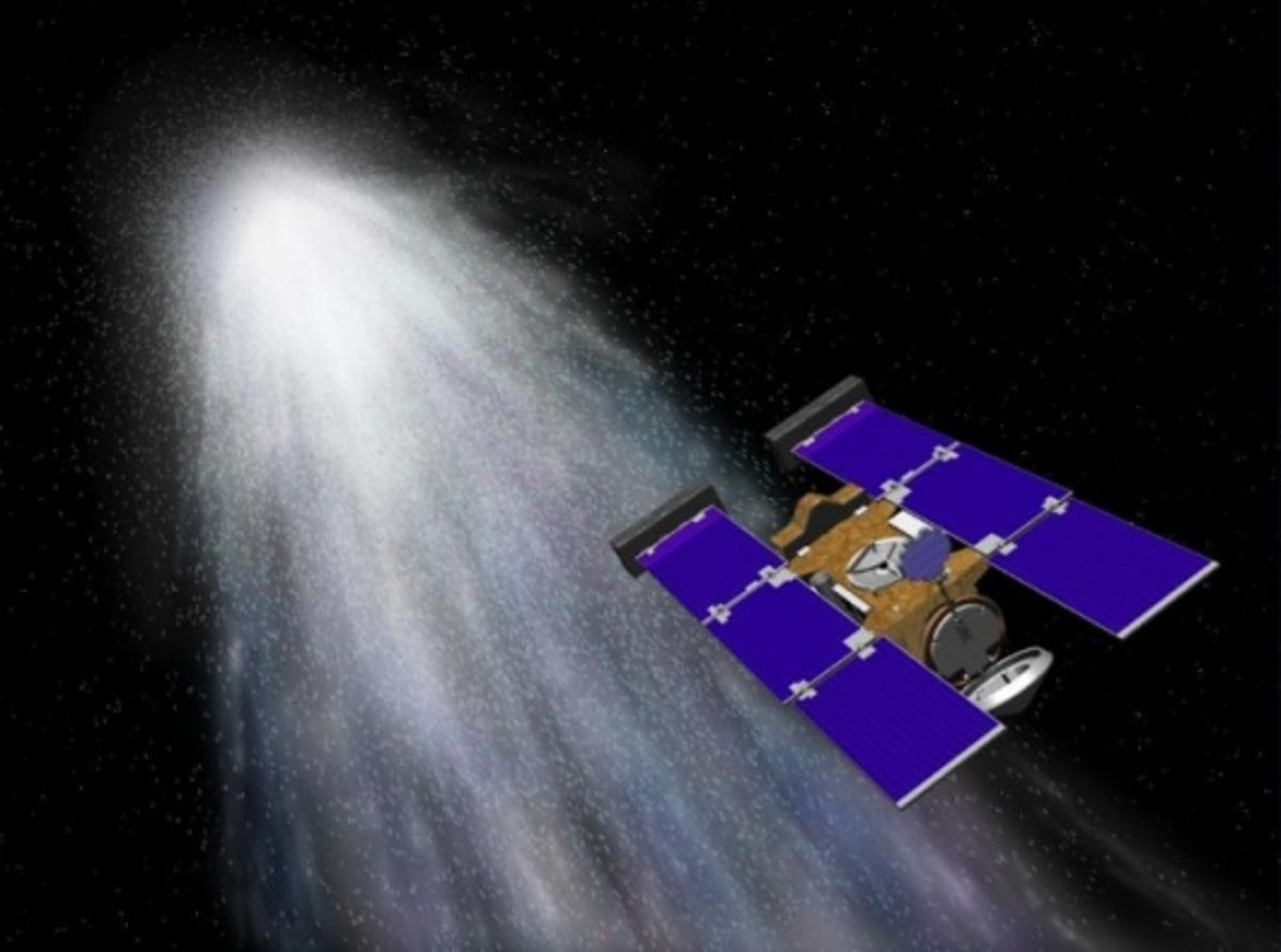Artist's conception of Stardust flying through gas and dust from comet Wild 2 (Image: NASA/JPL)