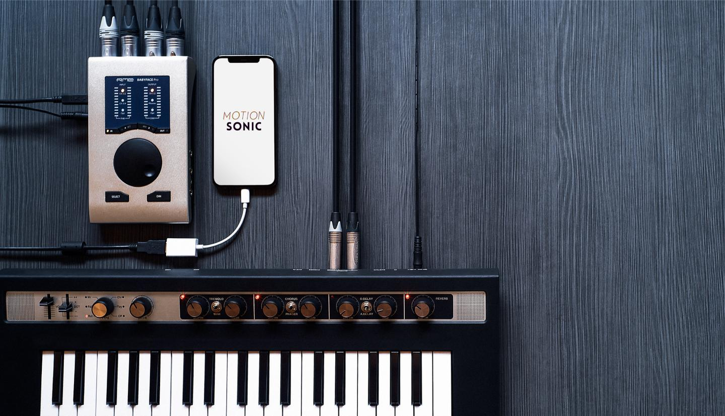 The Motion Sonic sensor works with an app running on an iPhone, which is cabled to an instrument via an audio interface