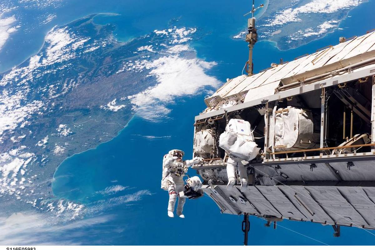 Astronauts toiling away on the International Space Station