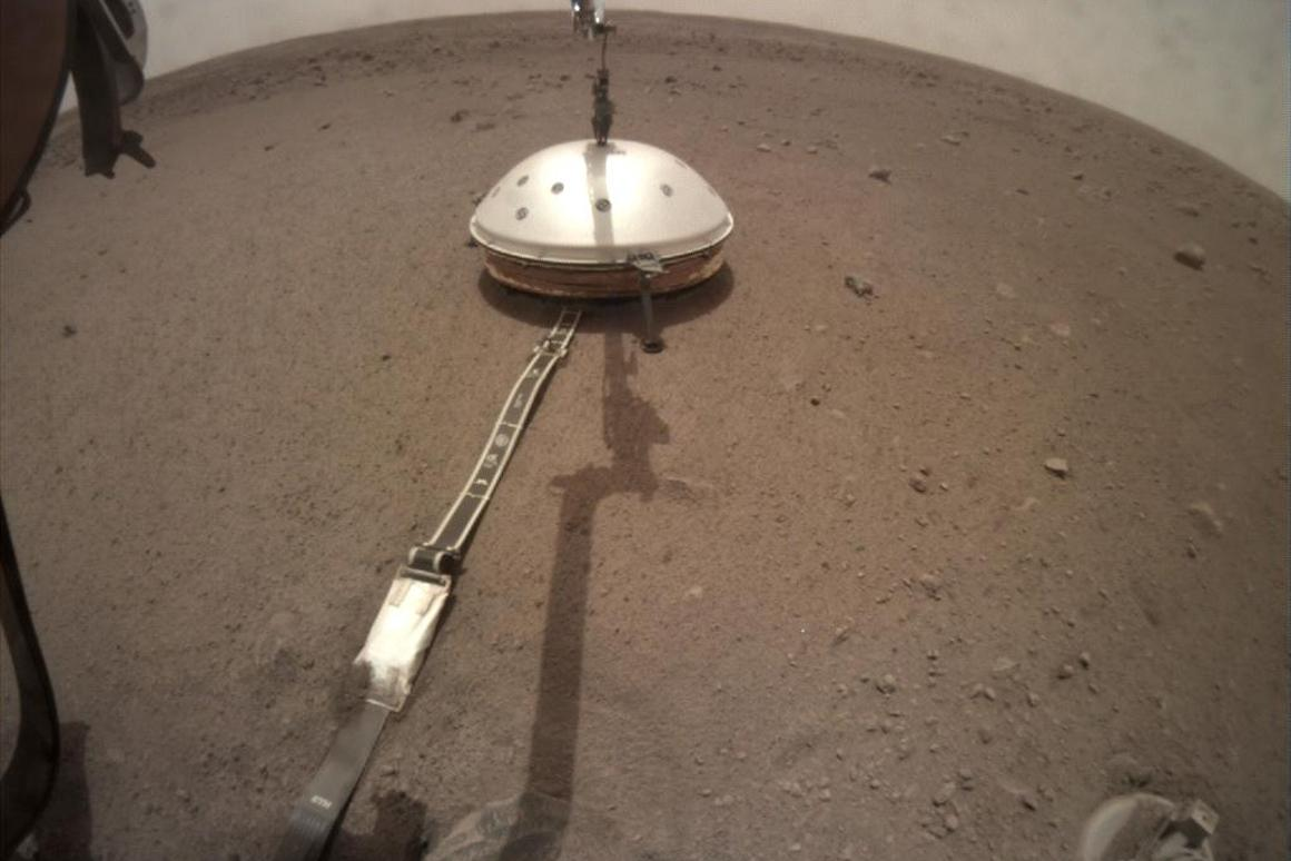 NASA's InSight lander has deployed its Wind and Thermal Shield to protect the seismometer package
