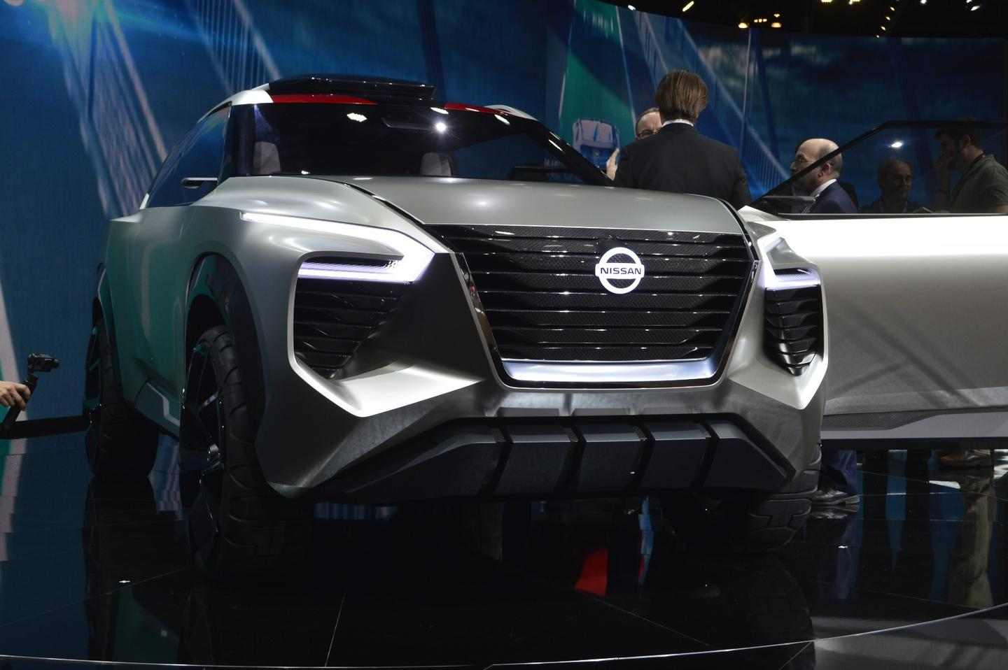 The front of the Nissan XMotion is thick with a wide grille, heavy overhang, and strong fenderwork over beefy tires and wheels