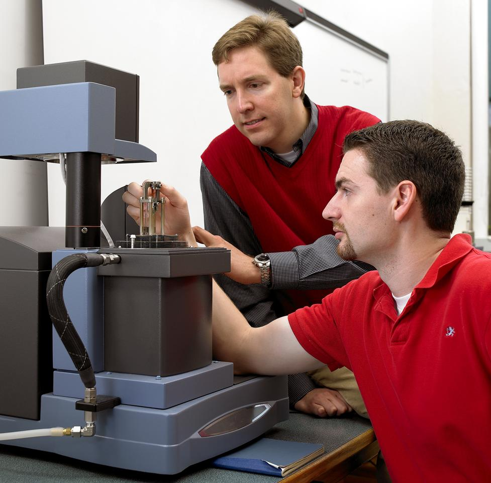 Michael Kessler (left) and former Iowa State doctoral student Will Goertzen use a dynamic mechanical analyzer to measure the mechanical properties of polymers (Photo: Michael Kessler)
