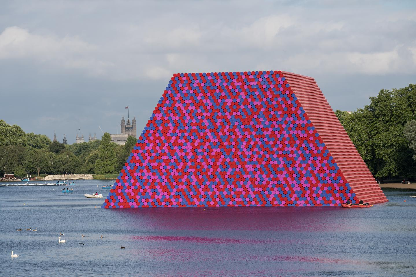 Not all of Christo and Jeanne-Claude's works were focused on fabric and wrapping things. The London Mastaba was a temporary sculpture in London's Hyde Park that consisted of oil barrels floating on a platform in the Serpentine Lake in 2018. In all, 7,506 horizontally stacked barrels were used