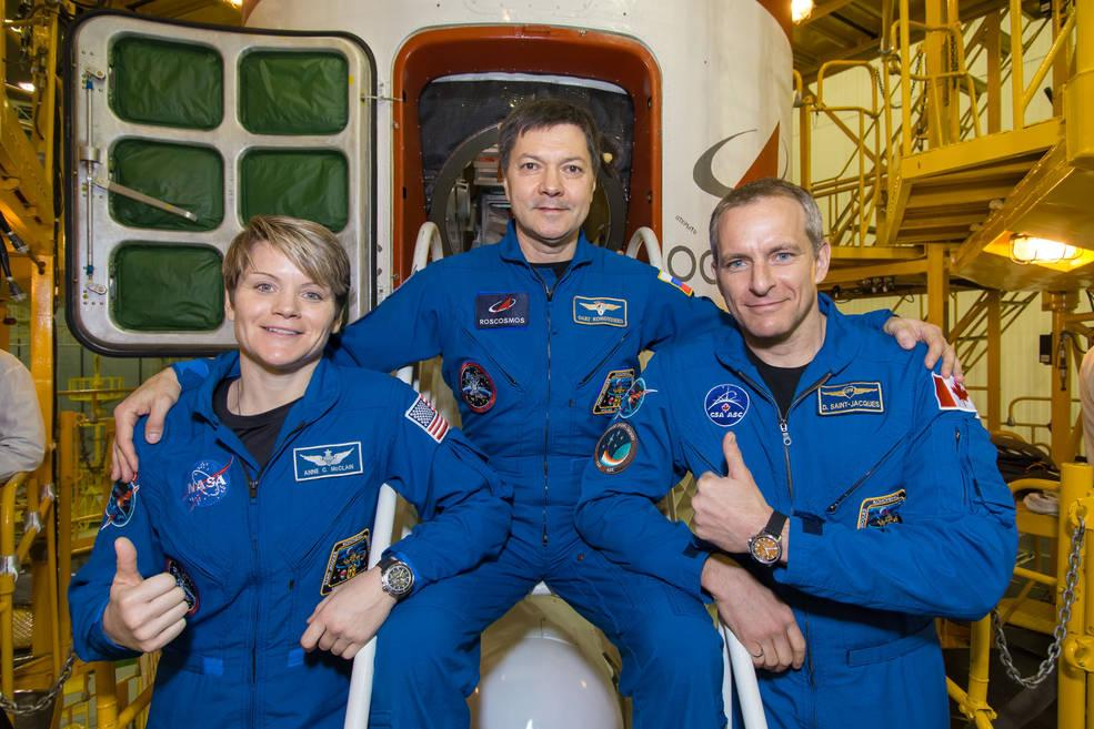 NASA astronaut Anne McClain (left) and her Expedition 58 crew members before departing Earth for the ISS