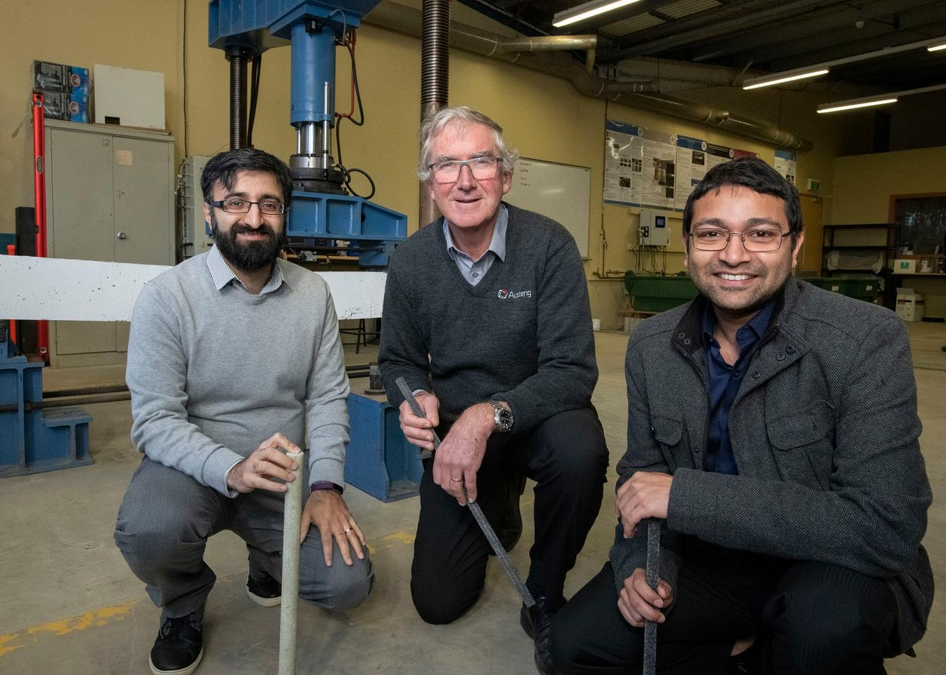 Deakin's Dr. Kazem Ghabraie, Austeng Engineering's Ross George and Deakin's Dr. Mahbube Subhani, with samples of the rebar