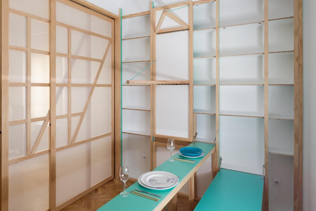 The fold-down furniture includes a bed, storage space, dining table, an ironing board, and even an acupuncture table