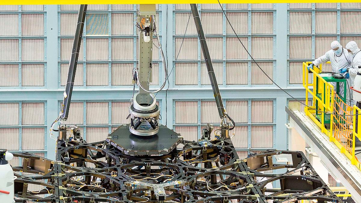The Goddard team used a robotic arm to carefully lower the hexagonal mirror into place