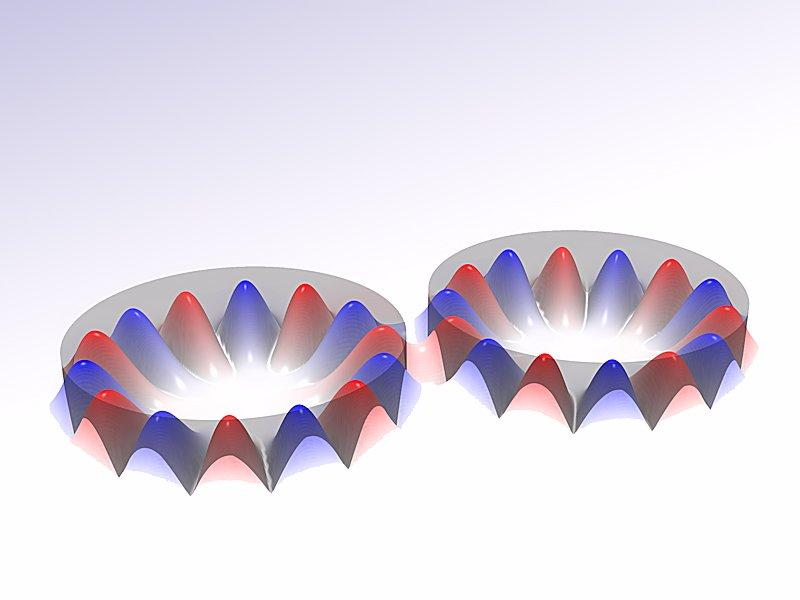 Optically coupled microlasers that turn each other on and off