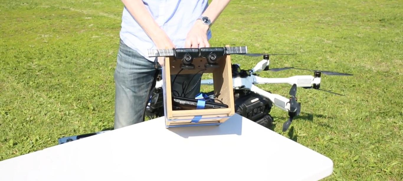 Intuitive Aerial outfitted one of its own Black Armored Drones with a makeshift wooden rig, carrying a laptop and two cameras arranged side-by-side