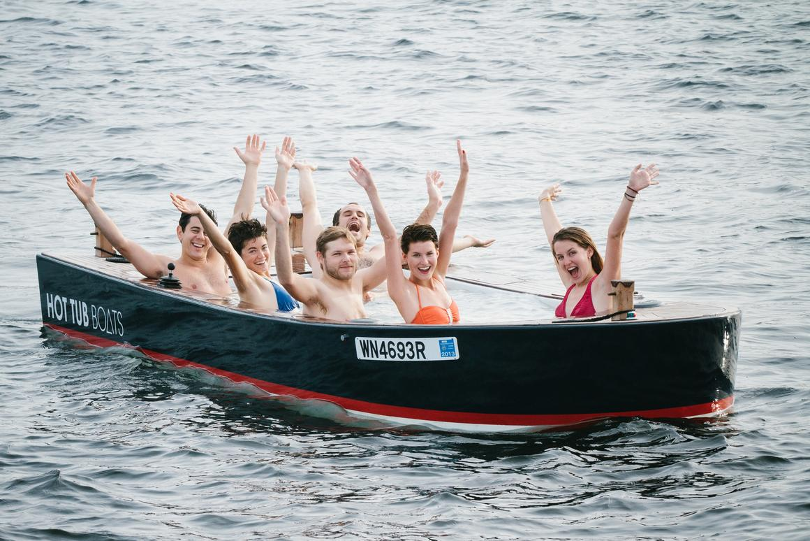 The Hot Tub Boat allows its passengers to soak while they cruise
