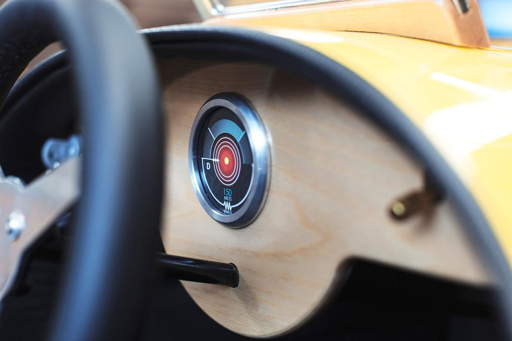 The EV3 Junior has a stylish wooden dash with a single circular vehicle information display