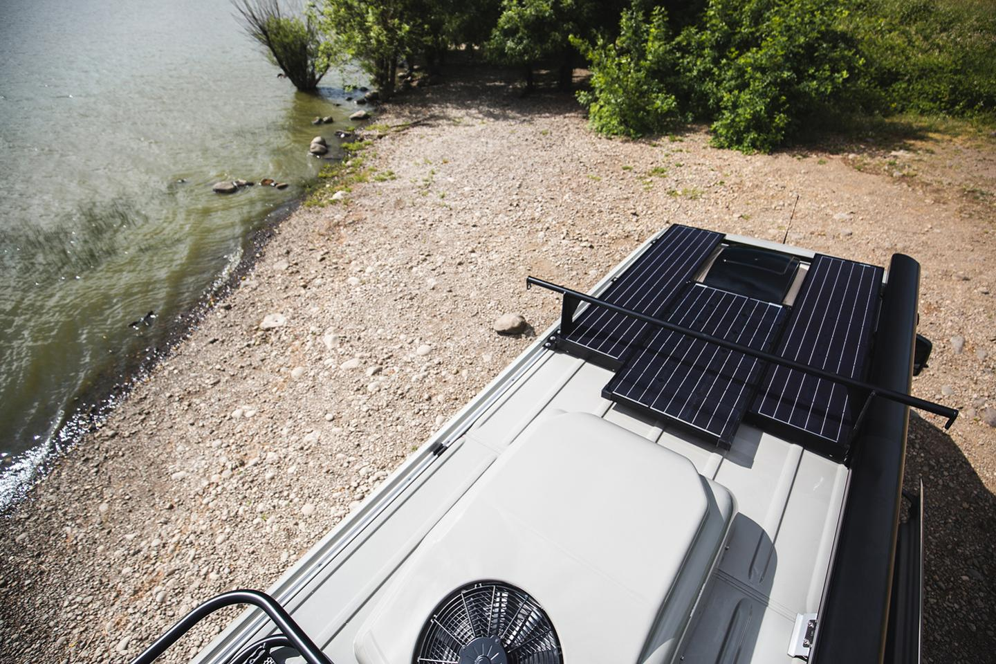 Outside Van puts the Mercedes Sprinter 4x4170 Extended'slong roof to use, adding on a trio of solar panels, anair conditioner and acustom cargo system