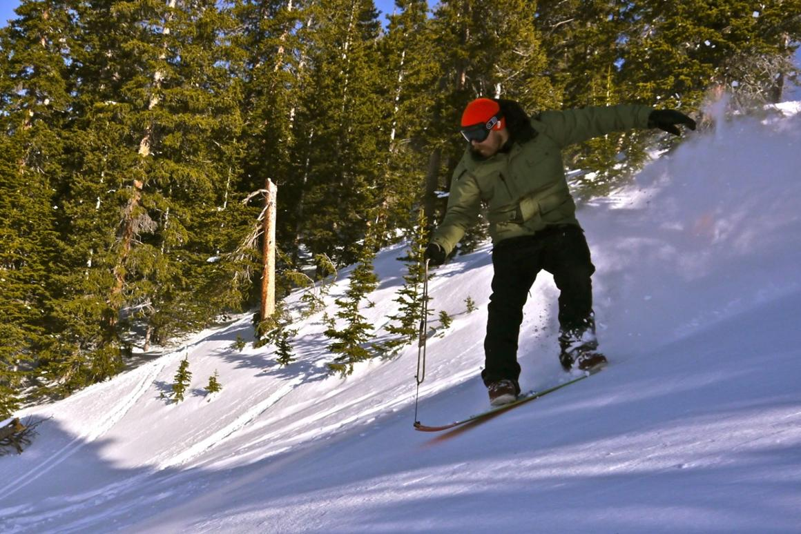 "The Signal crew surfs powder in roped ""Snurfer"" fashion Photo: Erin Paul Hines"