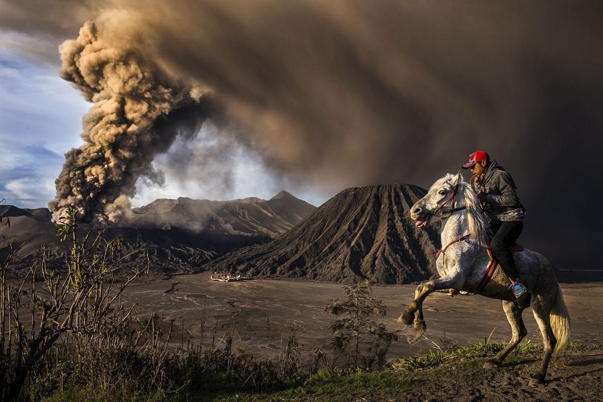 Second place in Journeys and Adventures category of the 2018 Siena International Photo Awards. The explosive eruption and loud rumbling of the Mt. Bromo volcano scared the horse causing it to rear up onto its hind legs