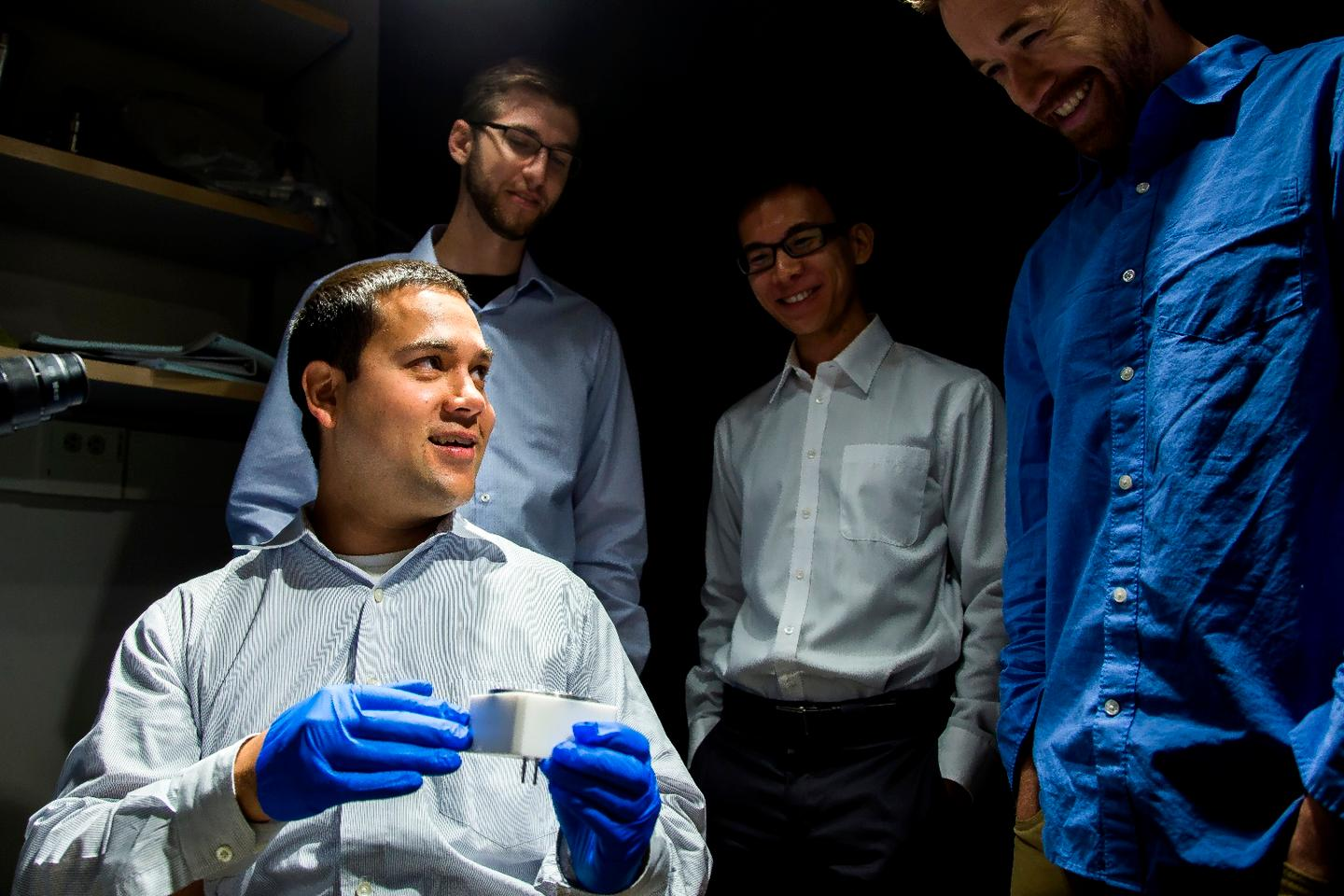 U of M researcher Neil Dasgupta and his team look at the battery window assembly
