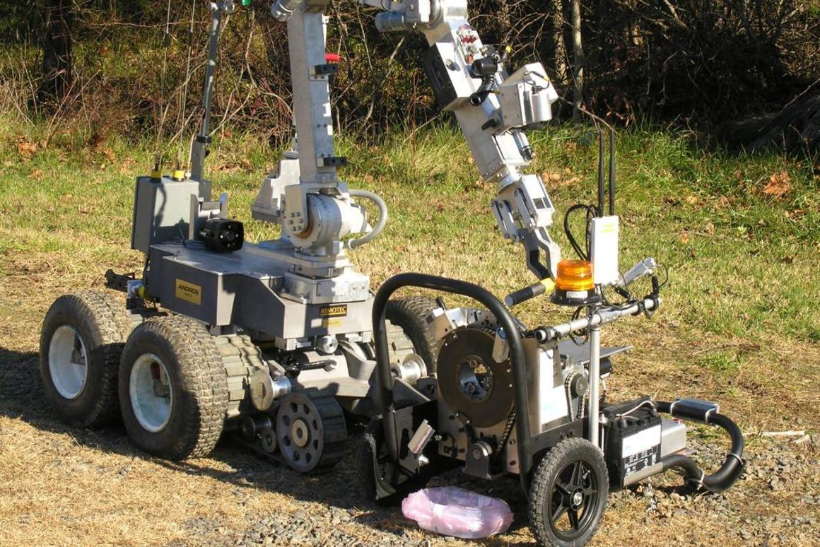 The SAPBER device (right), paired with an existing bomb disposal robot