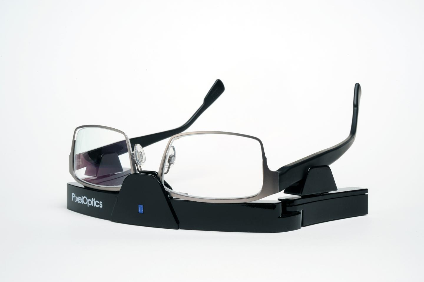 PixelOptics' emPower! electronic focusing glasses, in their charging stand