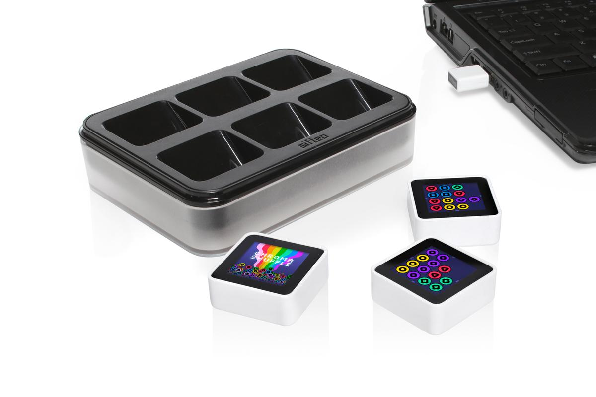 The Sifteo Cubes come shipped with a 6-bay dock and USB wireless link
