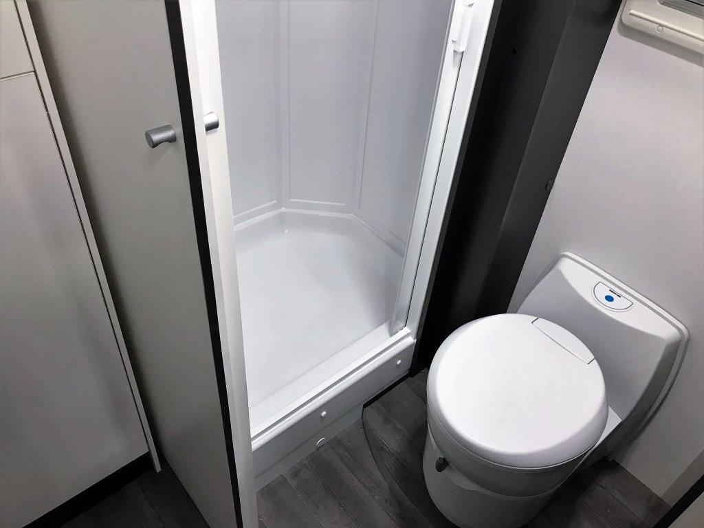 The Avida Rock has a dry bath layout with a shower compartment separated from the toilet area