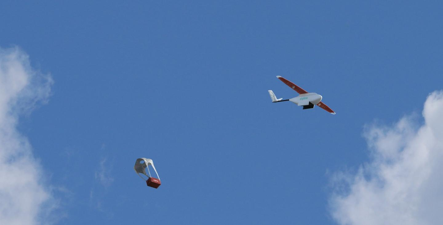 When the drone reaches its destination, its payload is released over a predetermined area and is parachuted down to the ground