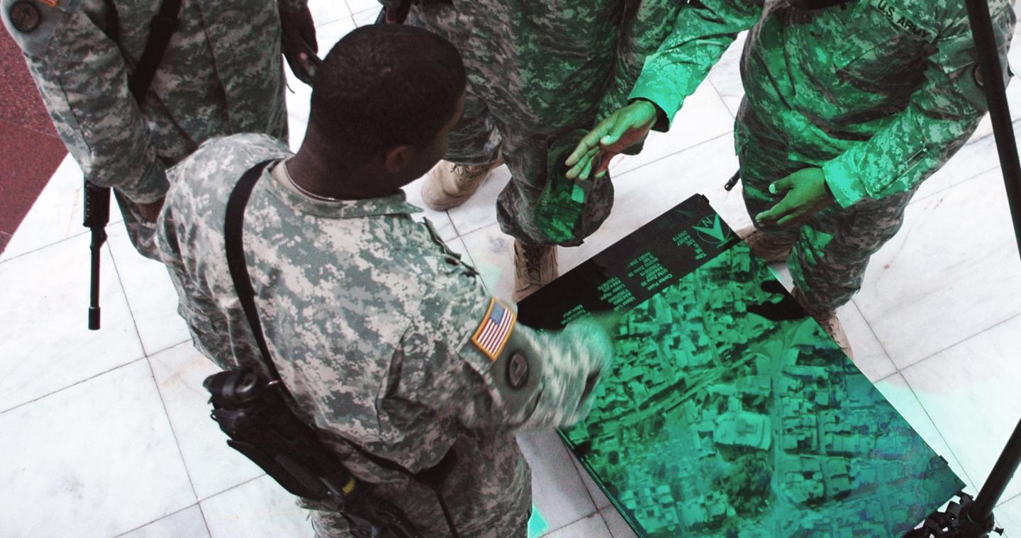 U.S. Soldiers prepare for a mission using Zebra Imaging's holograms as 3D maps (Image: Zebra Imaging & U.S. Army)