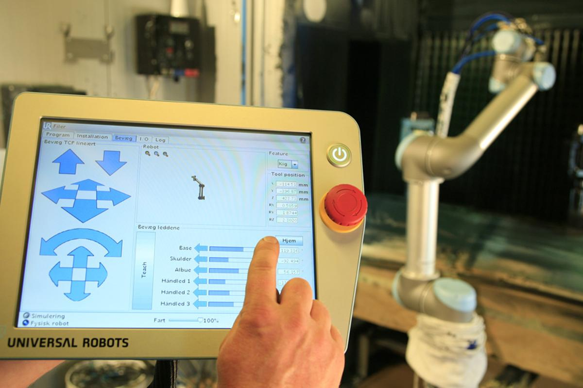 A new factory robot arm from Universal Robots is programmed using a simple GUI on an accompanying tablet