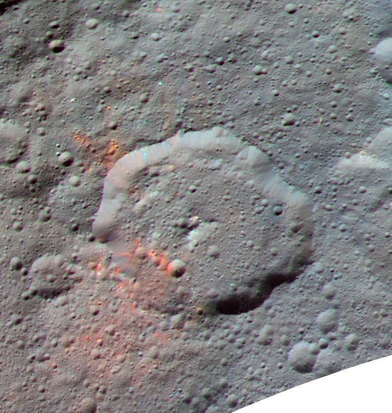 In this enhanced color image, the red spots indicate the scattering of organic molecules on Ceres