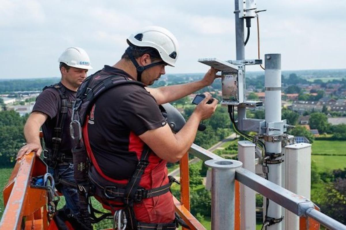 KPN technicians install a LoRa gateway onto a mobile transmission tower in the Netherlands, as part of the rollout of a new IoT-dedicated network