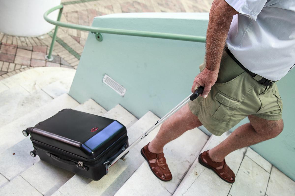 The user can tip the TraxPack onto its side and pull it up stairs, with built-in tracks allowing it to roll freely