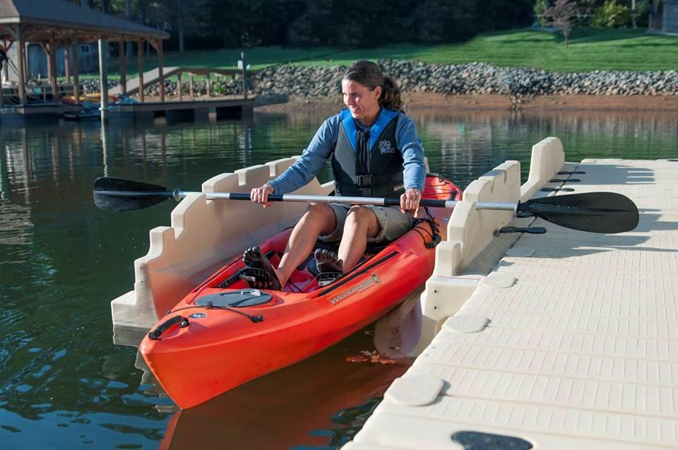 A kayaker uses the EZ Personal Launch to enter the water