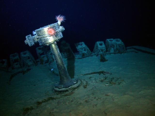 The emergency stern settering pedestal of the SS Gairsoppa shines in the lights of Odyssey's Remotely Operated Vehicle (ROV) during a visual inspection of the site approximately 4,700 meters deep