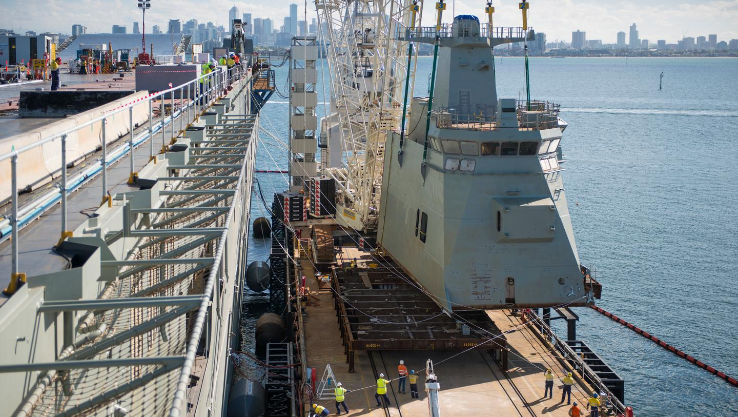 Raising superstructure module from dock (Photo: BAE Systems)