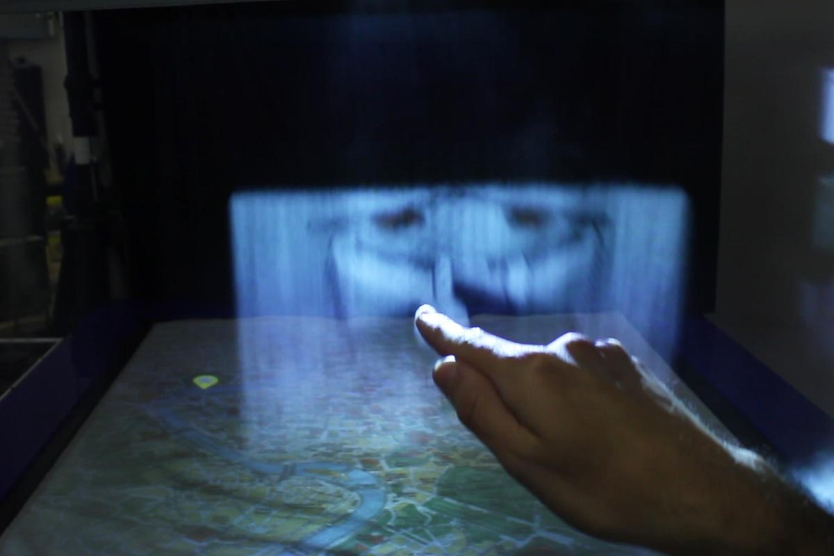 MisTable combines a 2D tabletop display with 3D personal fog screens (Photo: Bristol Interaction and Graphics group, University of Bristol, copyright © 2014)