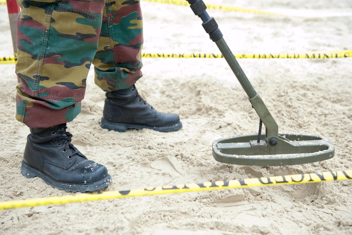 Conventional landmine-detection technologies (pictured) often identify other buried objects as mines