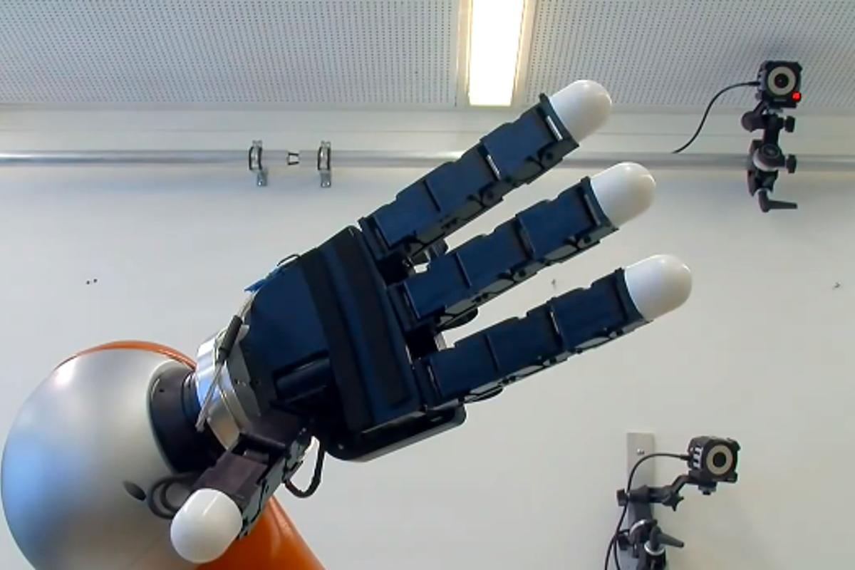 The robotic arm is capable of calculating the path of moving objects, moving to intercept them at staggering speed