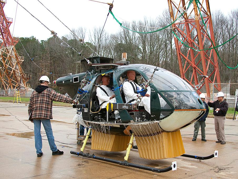 """Researchers at NASA's Langley Research Center are testing the """"deployable energy absorber"""" with the help of a helicopter donated by the Army and crash test dummies"""