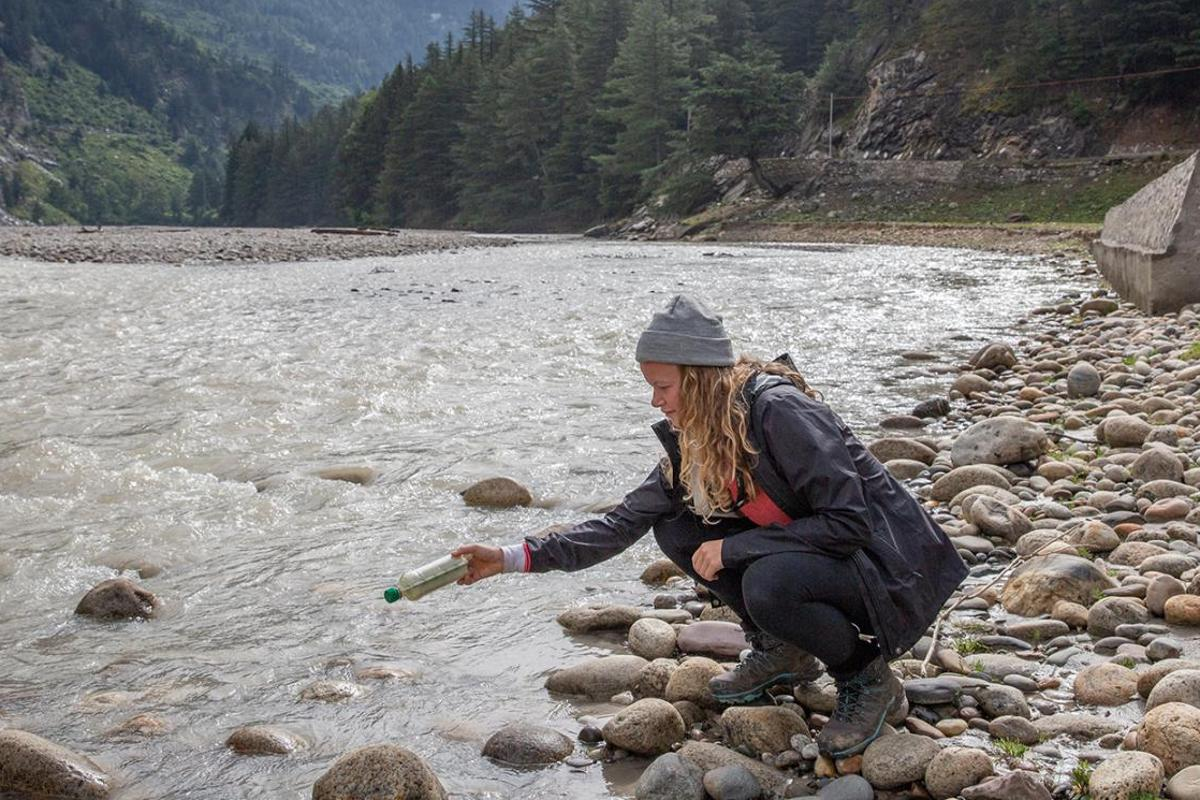 Lead author of the study Emily Duncan releases a tagged bottle into the Ganges river