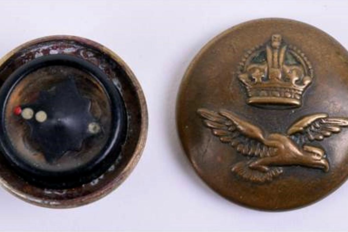 An RAF uniform button that conceals a compass is one of the items up for auction