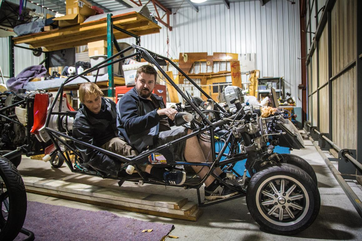 Loz Blain and Dezso in the two-seater G2 flying motorcycle (which isn't kitted out with its top rotor yet)