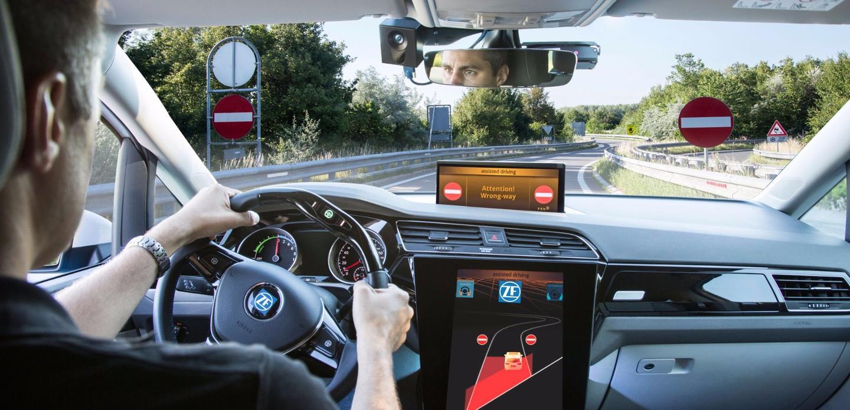 Behind the wheel of a car with wrong-way warning