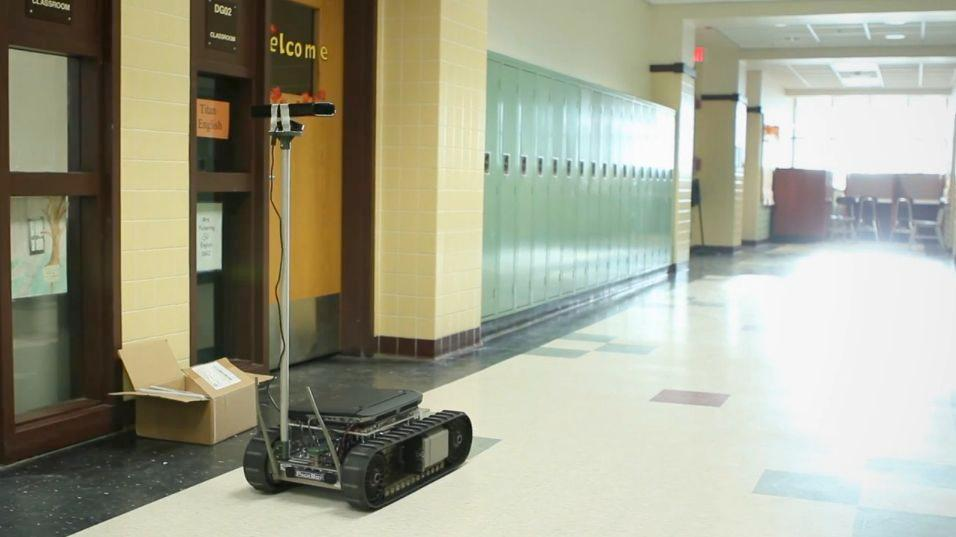 An iRobot PackBot navigates a school, in a demonstration of the Cognitive Patterns system