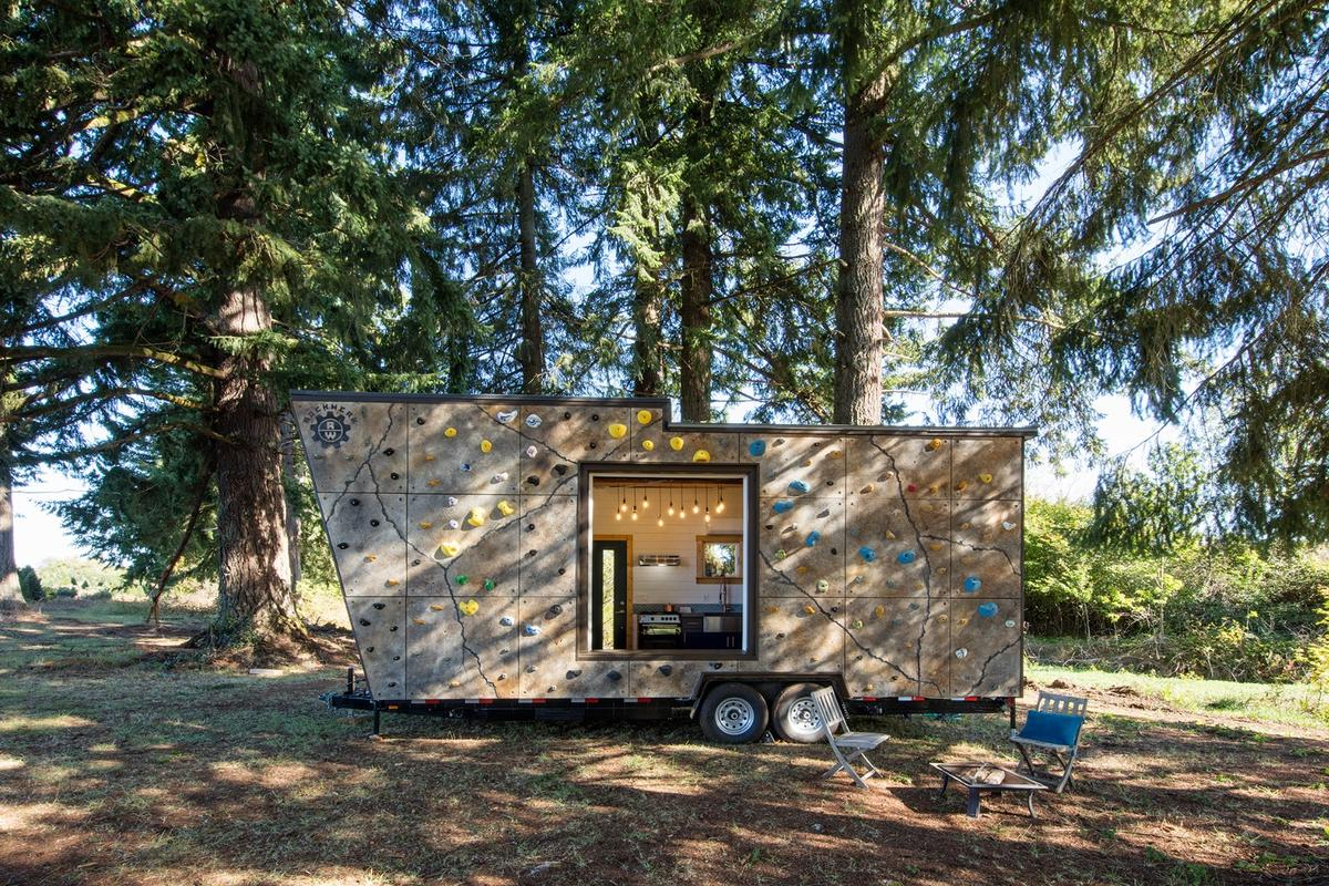 The Tiny Adventure Home features a rock climbing wall on its exterior