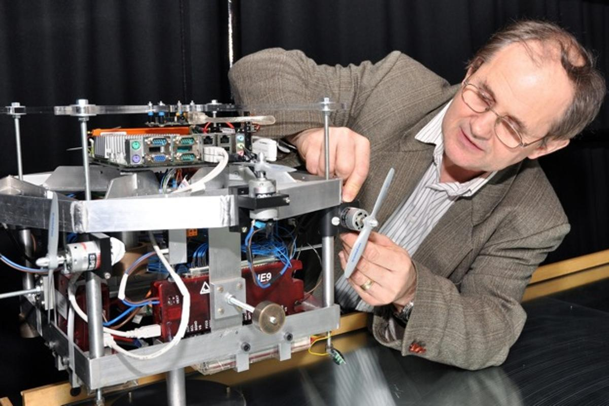 Southampton team leader Professor Sandor Veres, with one of the model satellites used to test sysbrain