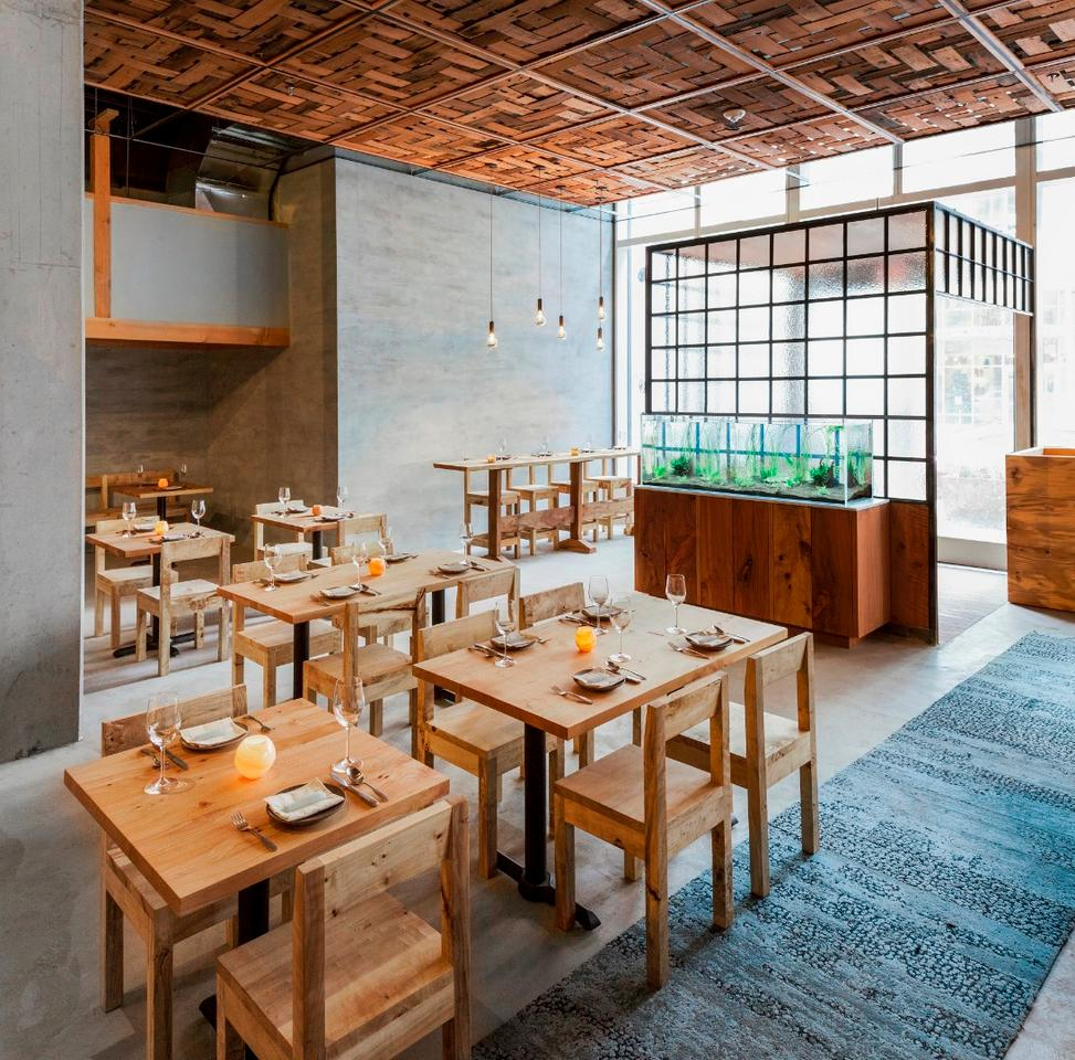Among the features of the Perennial's dining room are reclaimed lumber, a 100 percent recycled and recyclable rug, recycled tiles, plaster made from marble-processing waste and recycled glazing