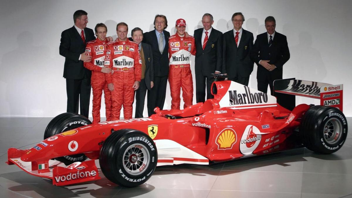 Another dream team of talent at the launch of the F2002: Ross Brawn (a key role in eight 8 constructors' championships and 8 drivers' championships including subsequently his own championship-winning team), reserve driver Luca Badoer, Rubens Barrichello, Jean Todt (a key role in four WRC championships, four Paris-Dakar wins, two Le Mans 24 Hour wins, and 14 F1 Titles and now FIA President), Ferrari Chairman Luca di Montezemolo, Michael Schumacher, F2002 designer Rory Byrne (whose cars have won 99 Grands Prix, seven constructor titles and seven drivers titles), Paolo Martinelli (head of Scuderia Ferrari Engine Department from 1994 to 2006), and then Fiat Chairman and CEO, Paolo Cantarella.