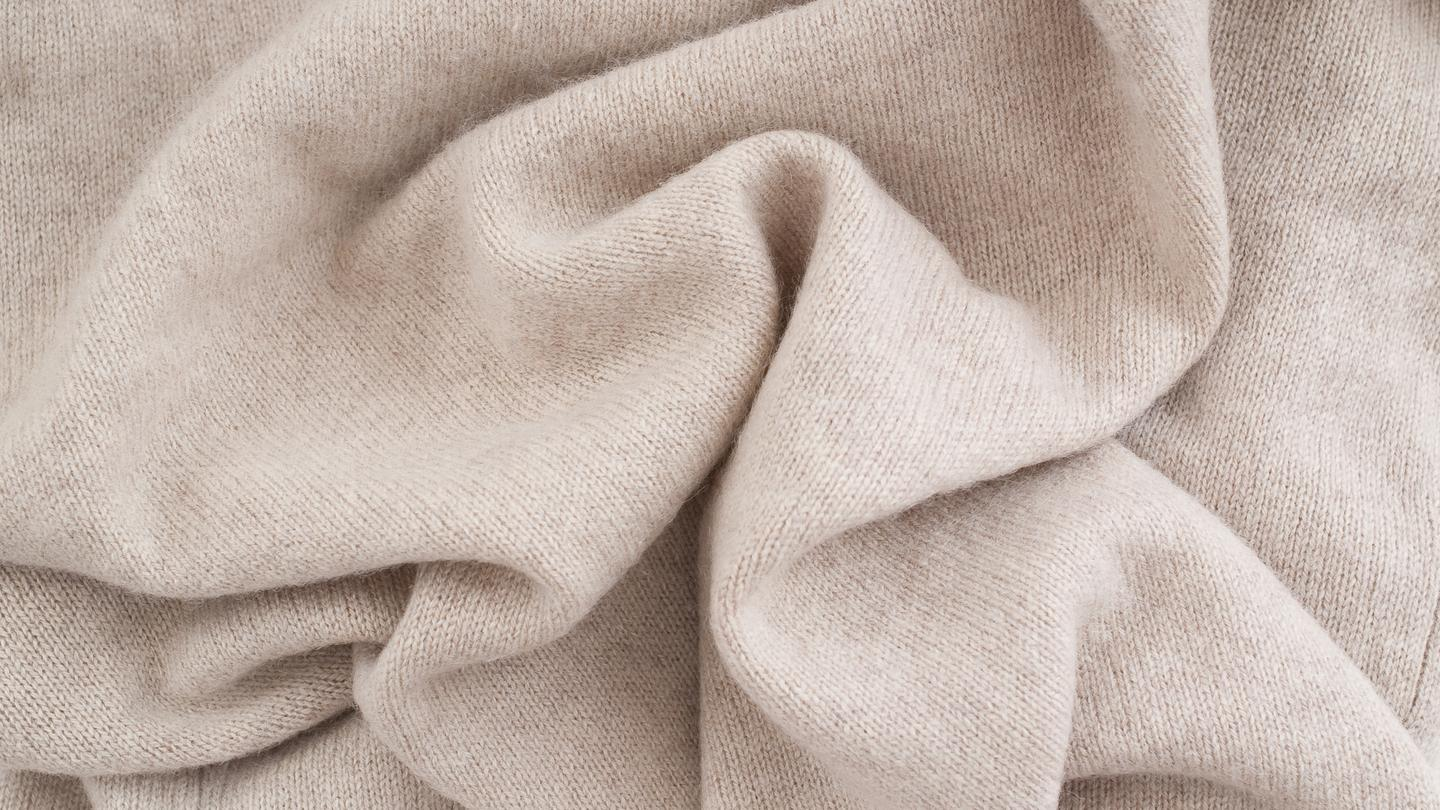 A self-cleaning nanoparticle coating removes stains from cashmere using light (Photo: Shutterstock)