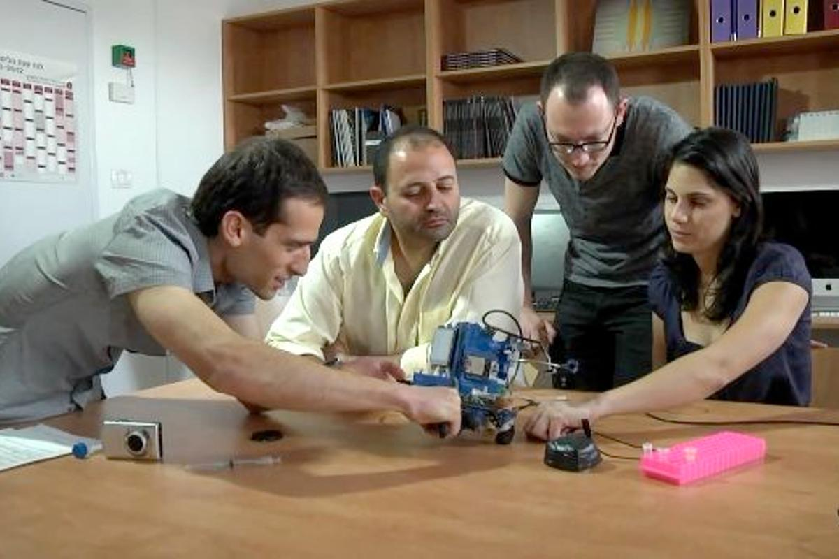 Some of the research team, with the SAGIV prototype