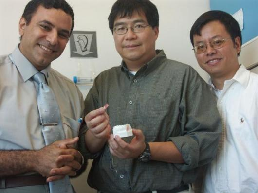 Dr. Tarak El-Bialy, Ying Tsui and Dr. Jie Chen with the prototype