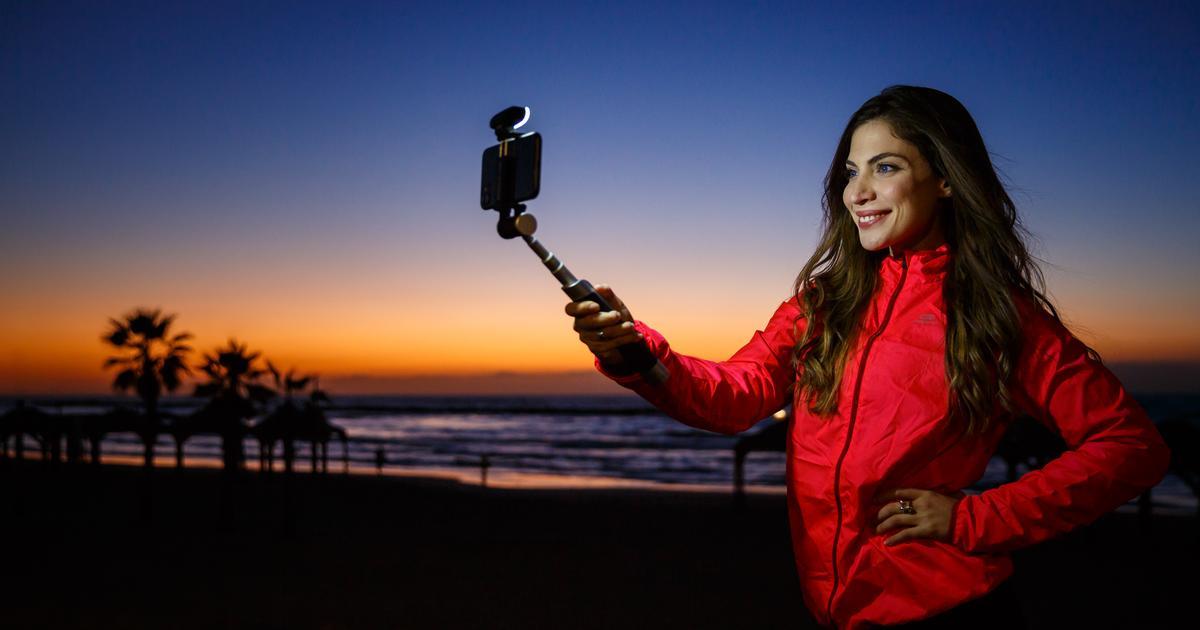 Smart selfie stick's features include a remote-control spotlight
