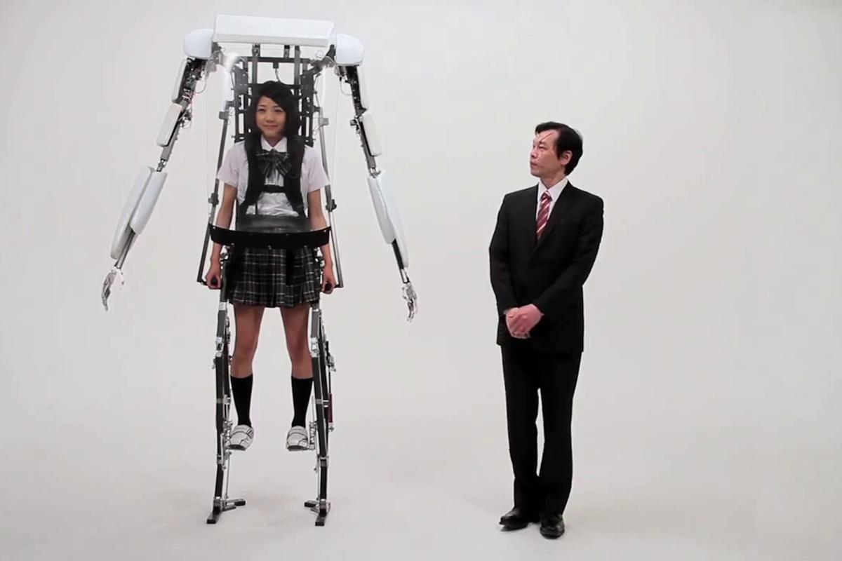 A school girl wearing Sagawa Electronics' Power Jacket MK3 stands above a grown man